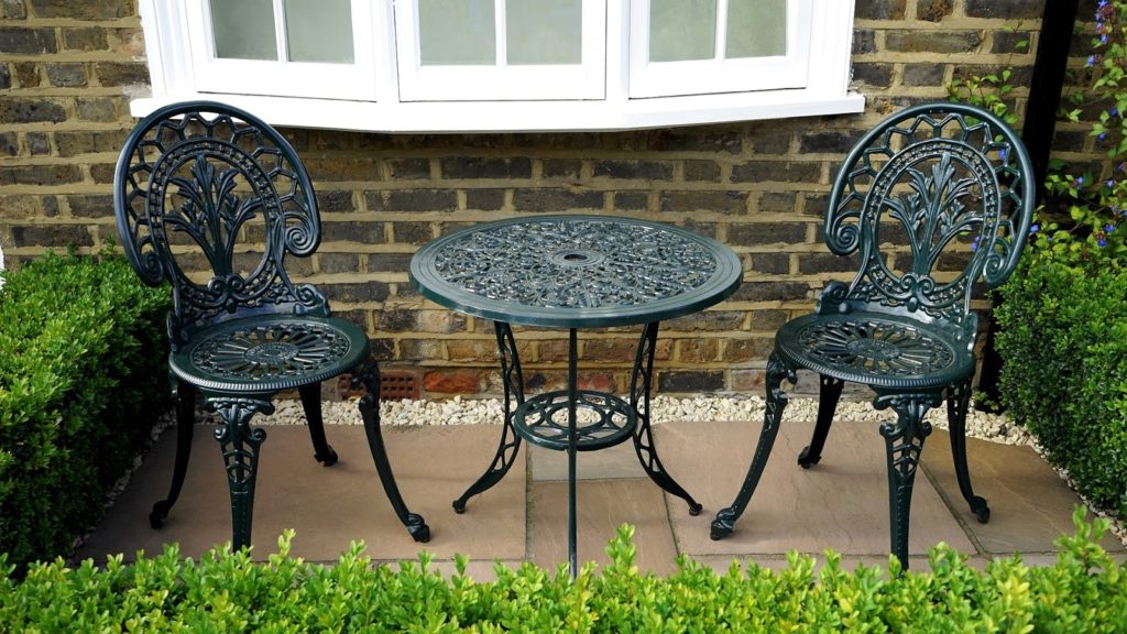 Add a seating area in your yard to improve the landscape and curb appeal.