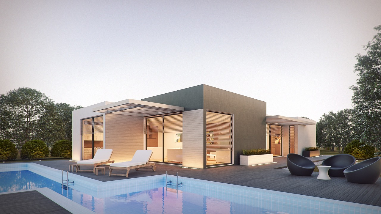This rectangular pool and modern home make use of concrete and clean, sharp lines for a minimalistic effect.